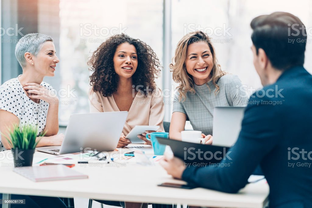 Women take the leading role in business stock photo