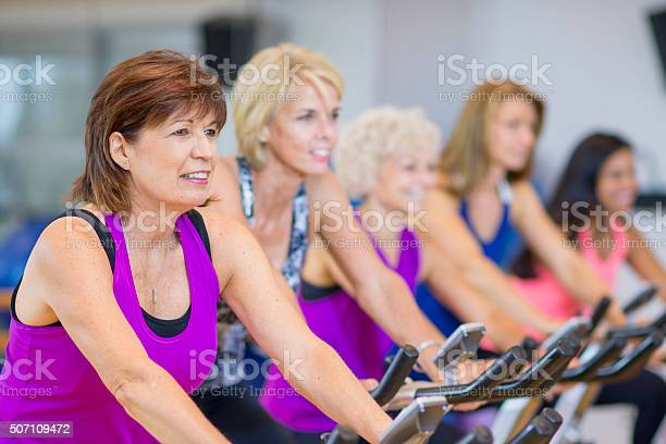 Women taking a cycling class on stationary bikes picture id507109472?b=1&k=6&m=507109472&s=612x612&h=3otlzxrjnrvx4sgt9onzswrh3xhzttghx402tnwsvqg=