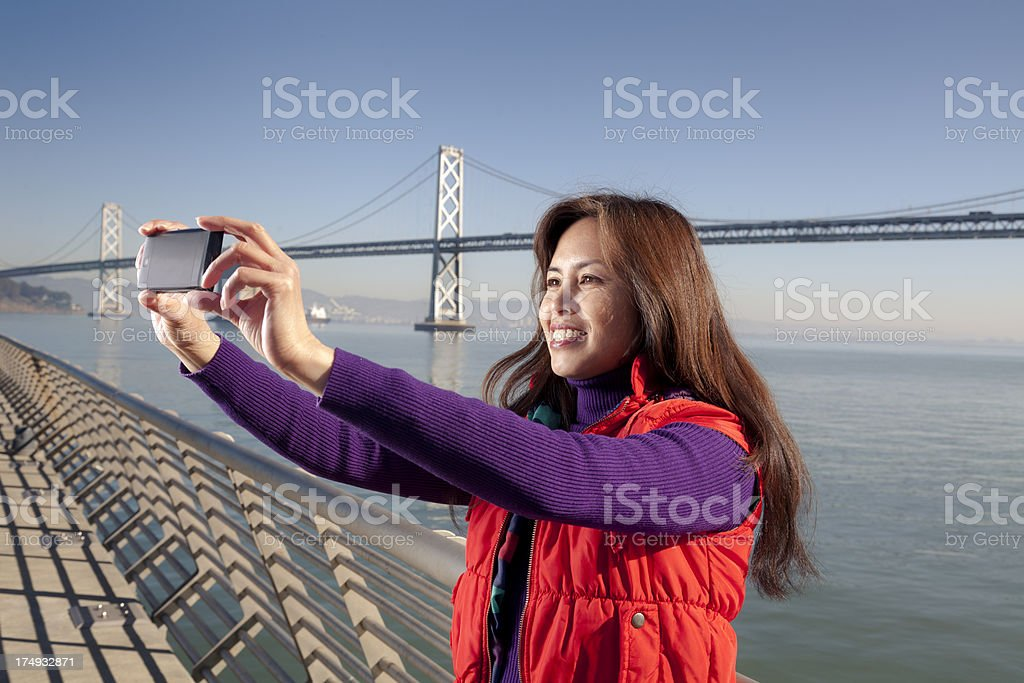 Women Taking a Photo royalty-free stock photo