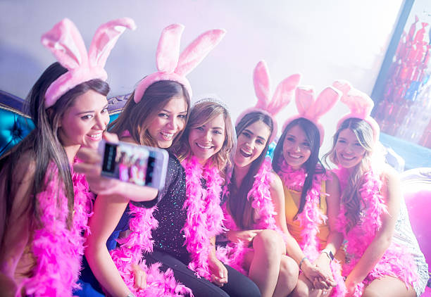 Women taking a selfie at a bachelorette party stock photo