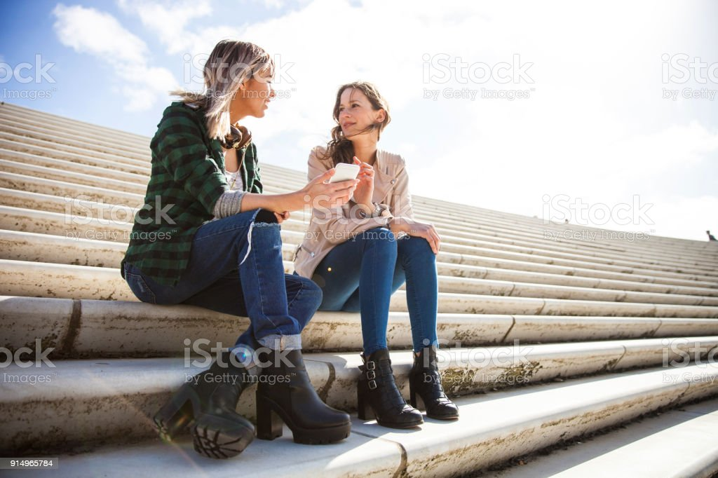 Women talking and chilling on social media stock photo