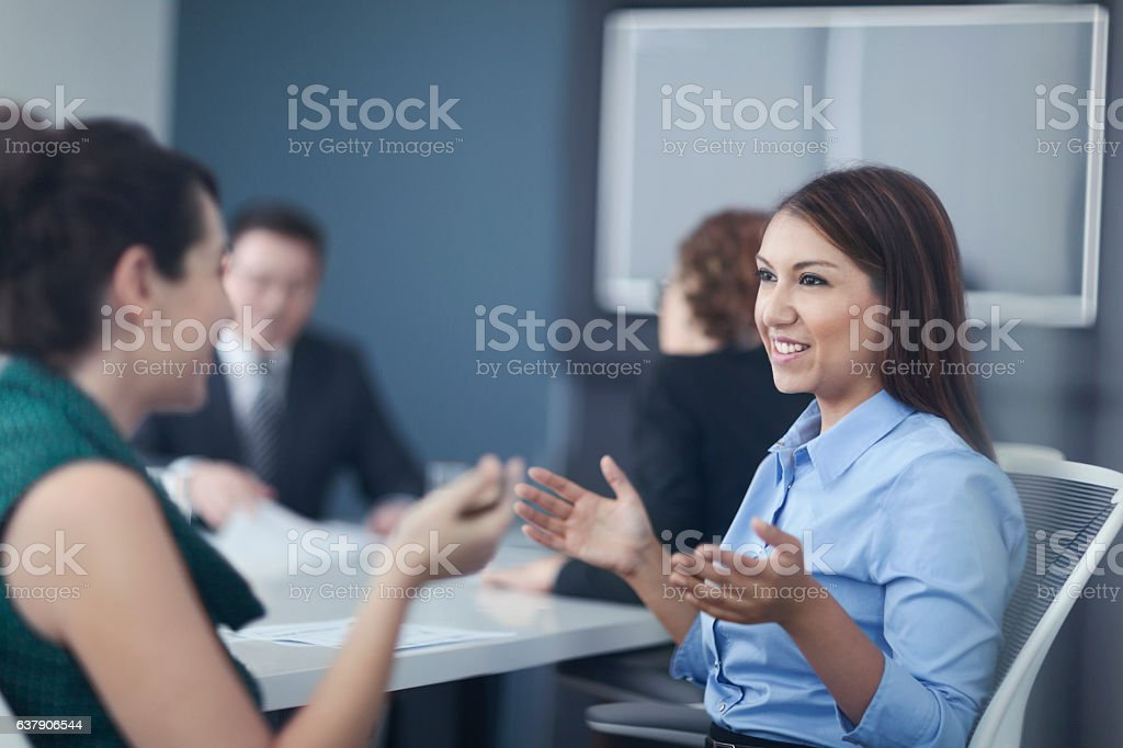 Women talking together in business office meeting​​​ foto