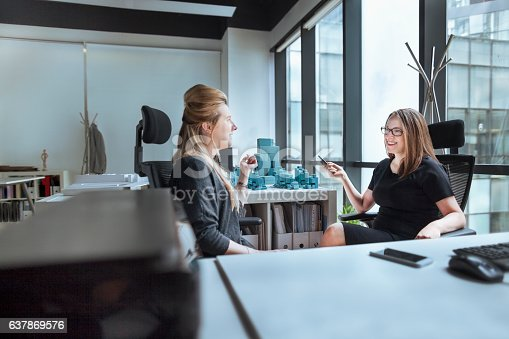 istock Women talking together in design office 637869576