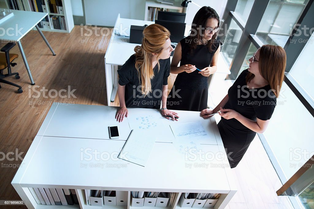 Women talking together in design planning office - Photo
