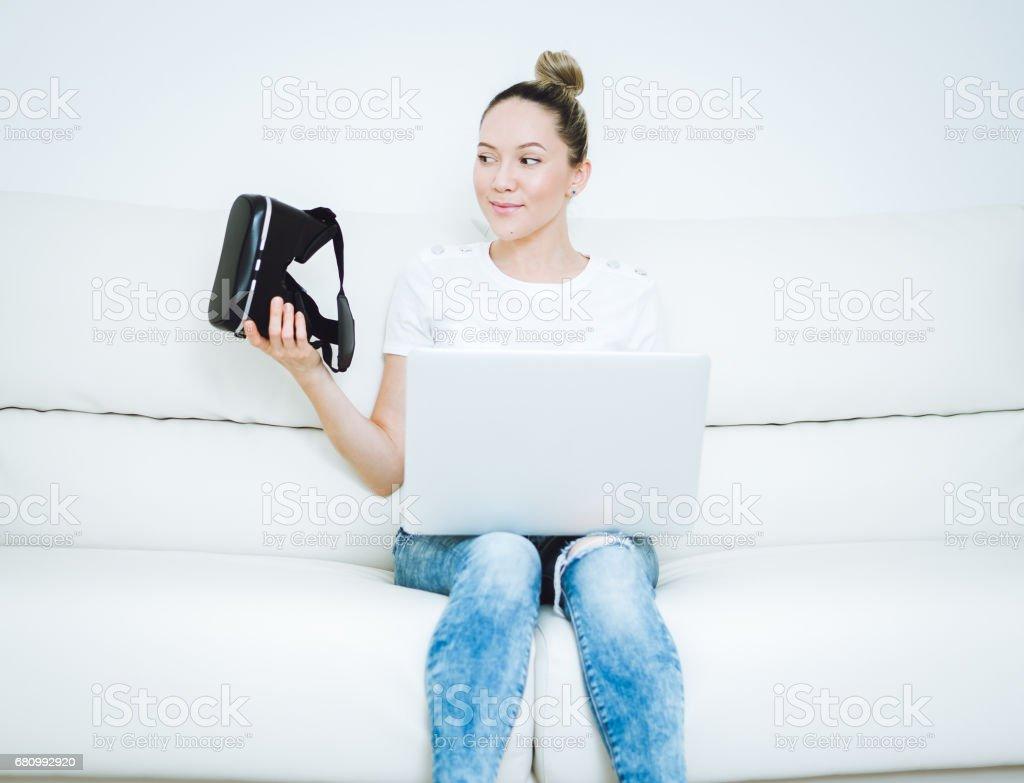 Women testing Virtual Reality simulator at home royalty-free stock photo