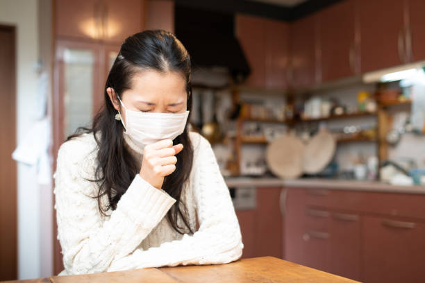 Women to cough wearing a mask stock photo