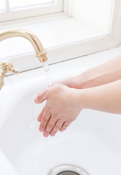 women to hand-washing - handwashing stock photos and pictures