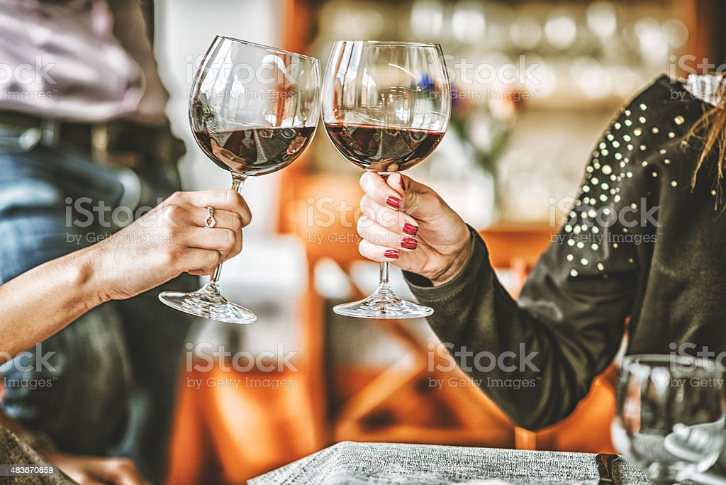 Women toasting at restaurant royalty-free stock photo