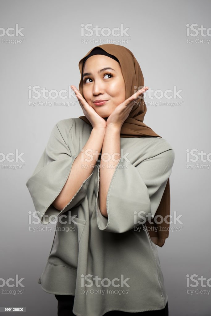 A women touch her face and smile with excitement stock photo