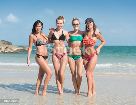 Four beautiful women in bikinis in a playful by the Ocean. Nikon D810. Converted from RAW.