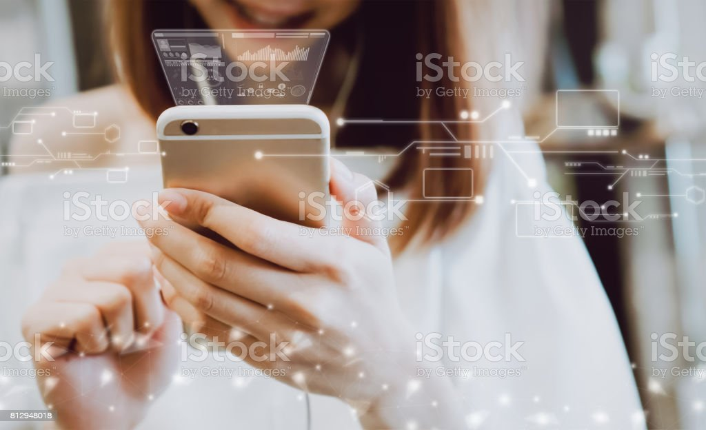 Women using a smartphone in the display and technology advances in stores. Take your screen to put on advertising. - foto stock