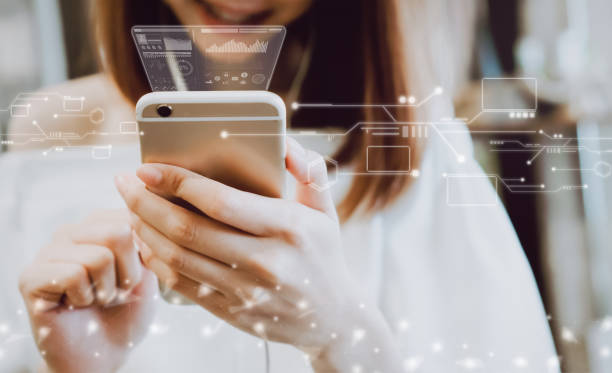 women using a smartphone in the display and technology advances in stores. take your screen to put on advertising. - dispositivo informatico portatile foto e immagini stock