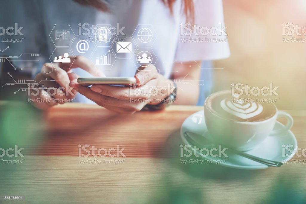 Women using a smartphone in the display and technology advances in stores.The concept of working anywhere with modern technology. stock photo