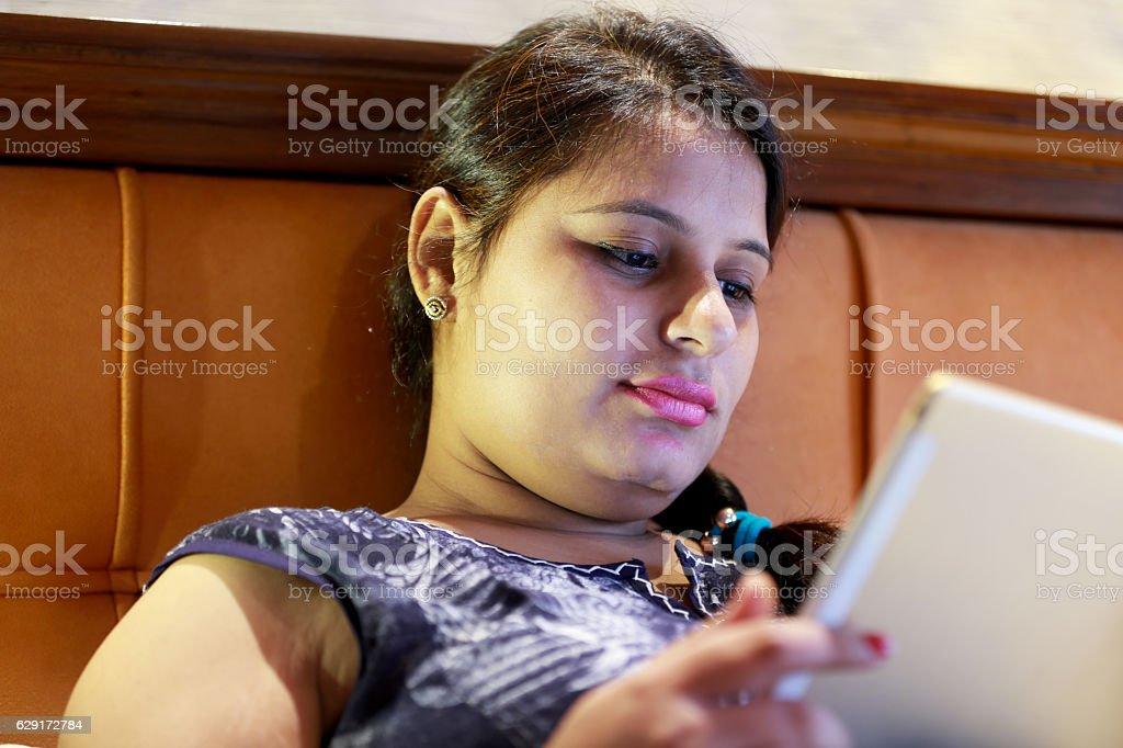 Women using ipad in hotel room stock photo