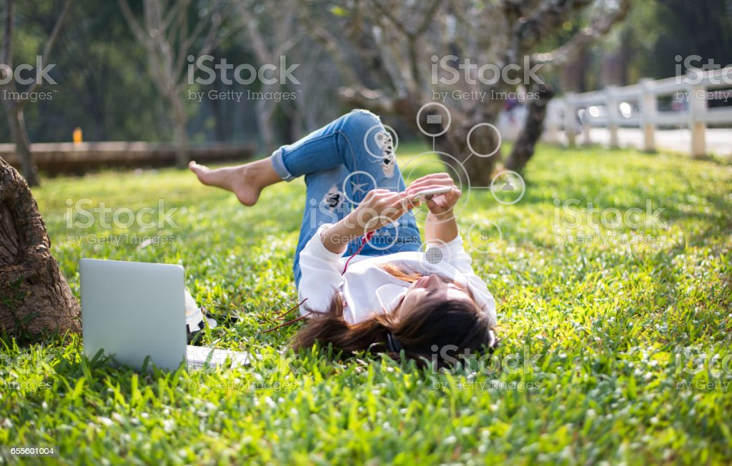 Women using mobile payments online shopping and icon customer network connection on screen, in the nature park stock photo