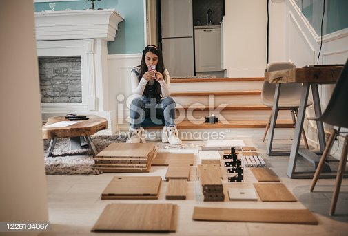 459373065 istock photo women using phone at hom 1226104067
