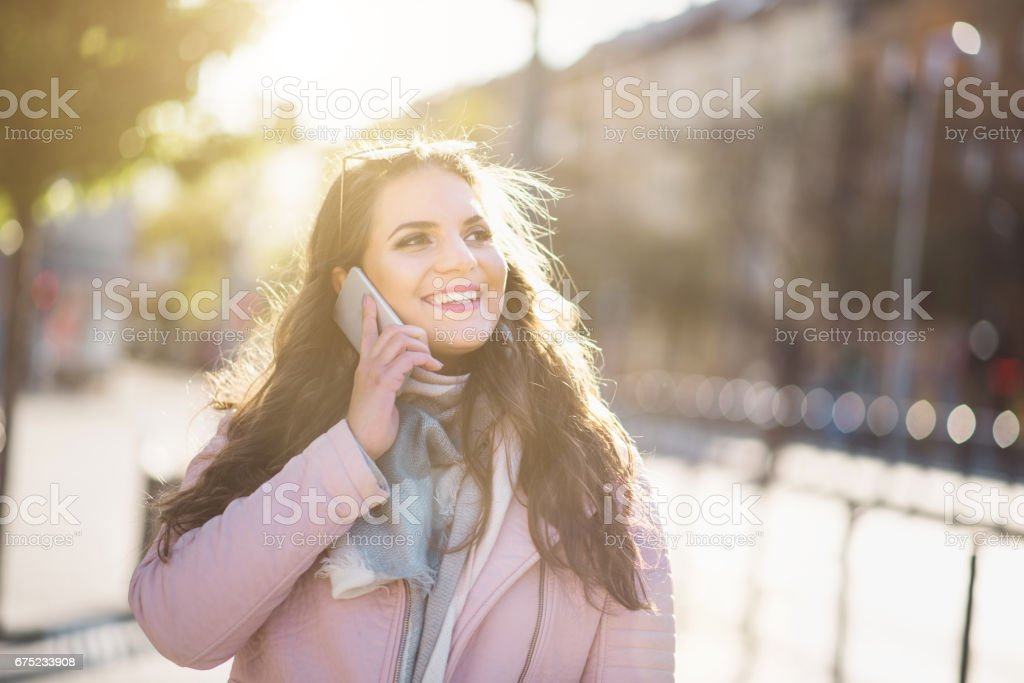 women using phone in budapest royalty-free stock photo