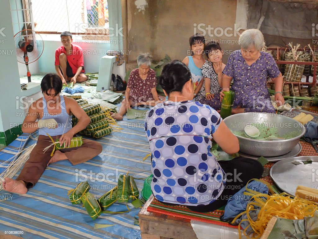 women Vietnam is package tet cakes for Lunar New Year. stock photo