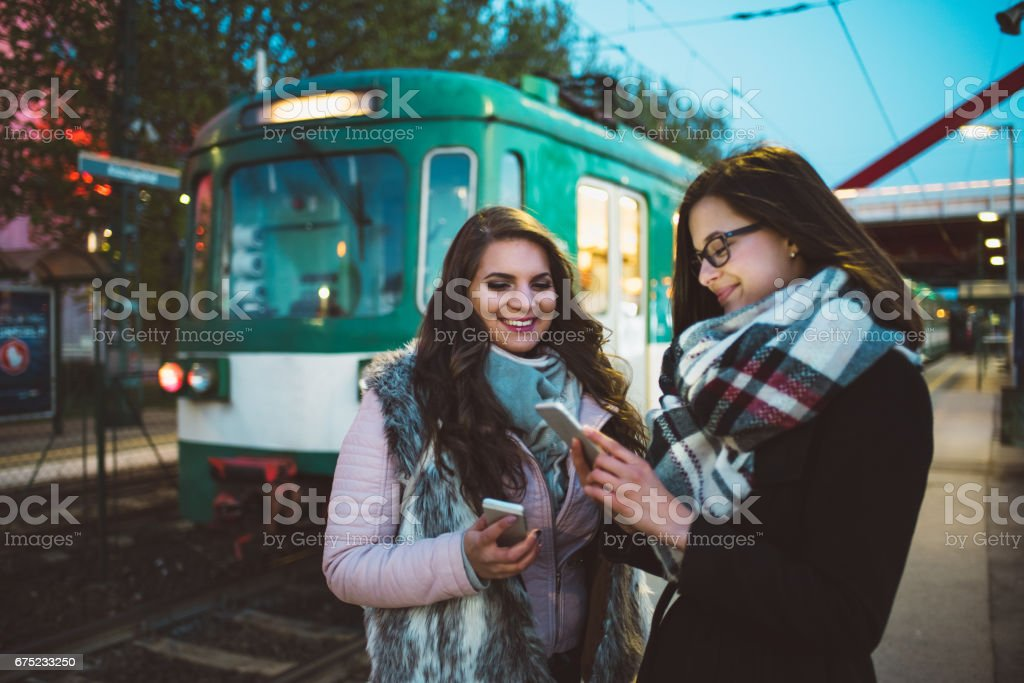 women waiting for the train royalty-free stock photo