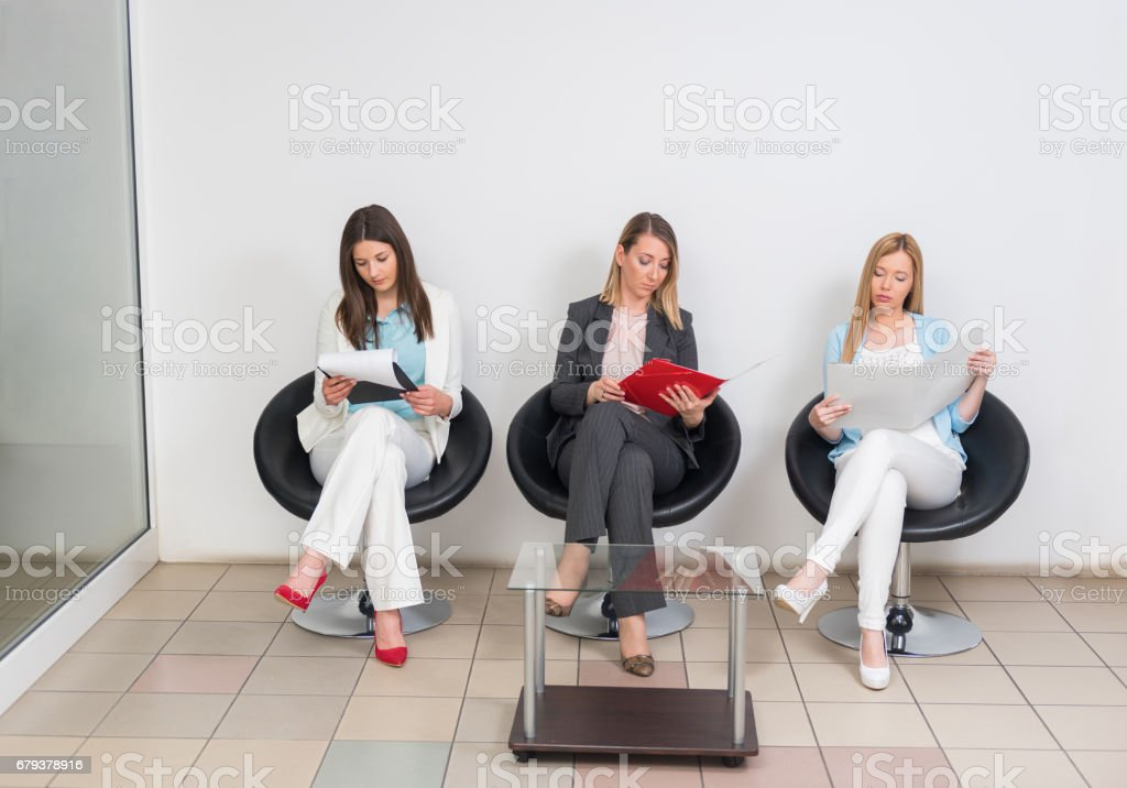 Women waiting in office for a job interview stock photo