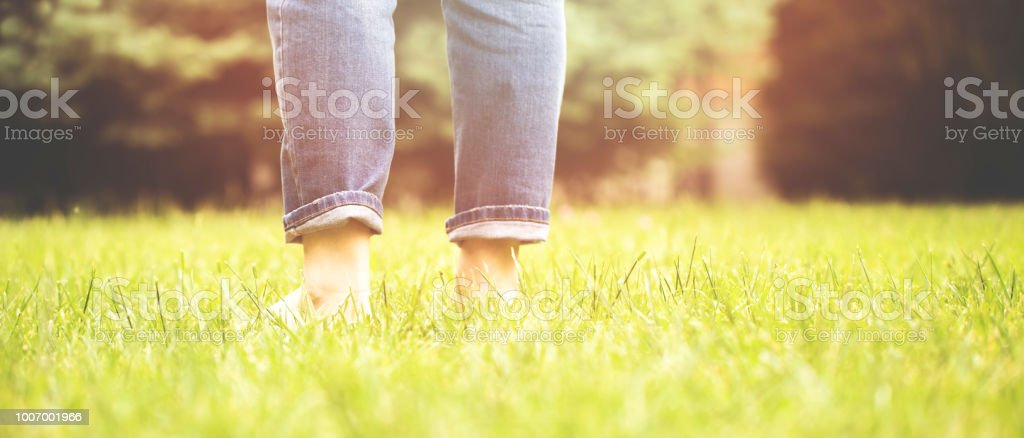 women walk in the grass stock photo