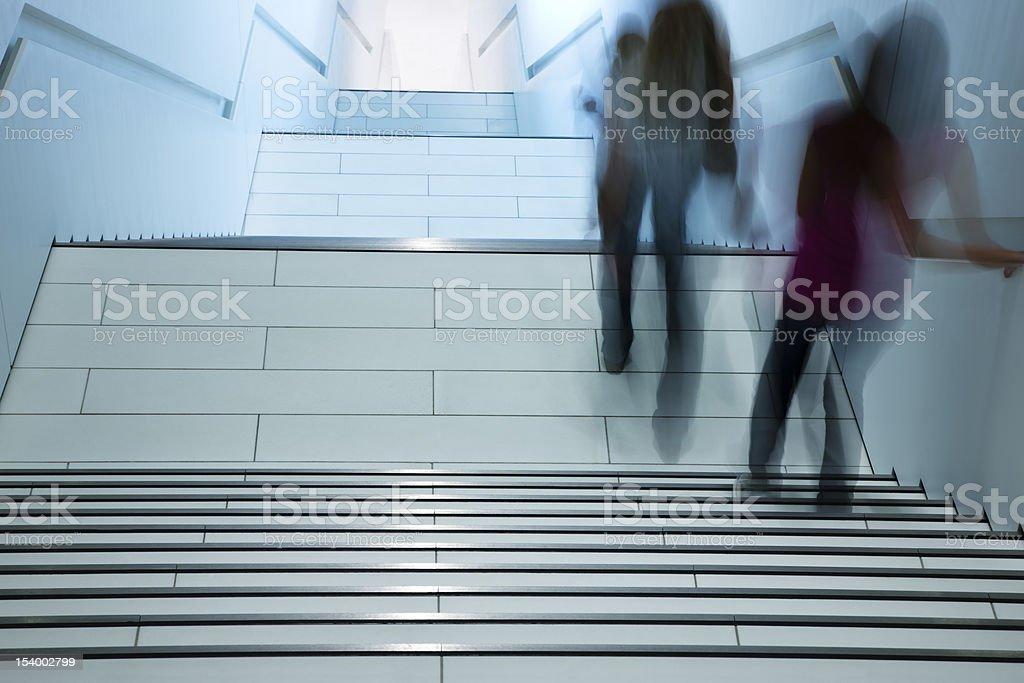 Women Walking Down Stairs in Modern Interior, Motion Blur royalty-free stock photo