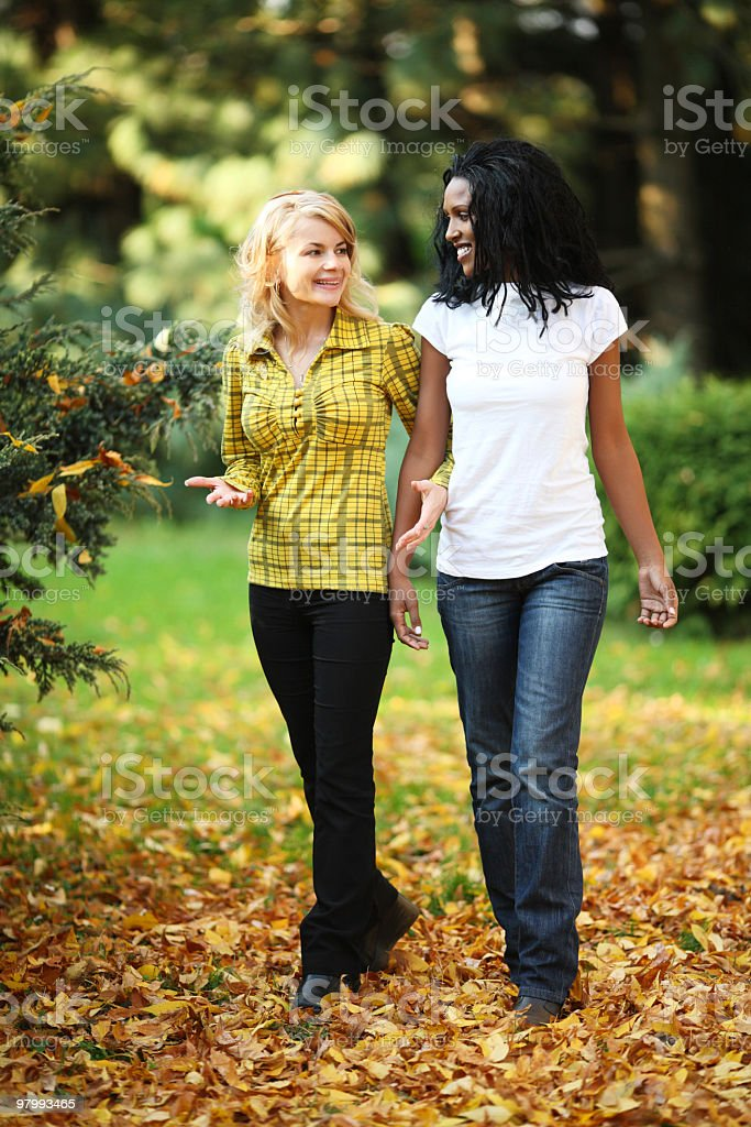 Women walking in the park royalty-free stock photo
