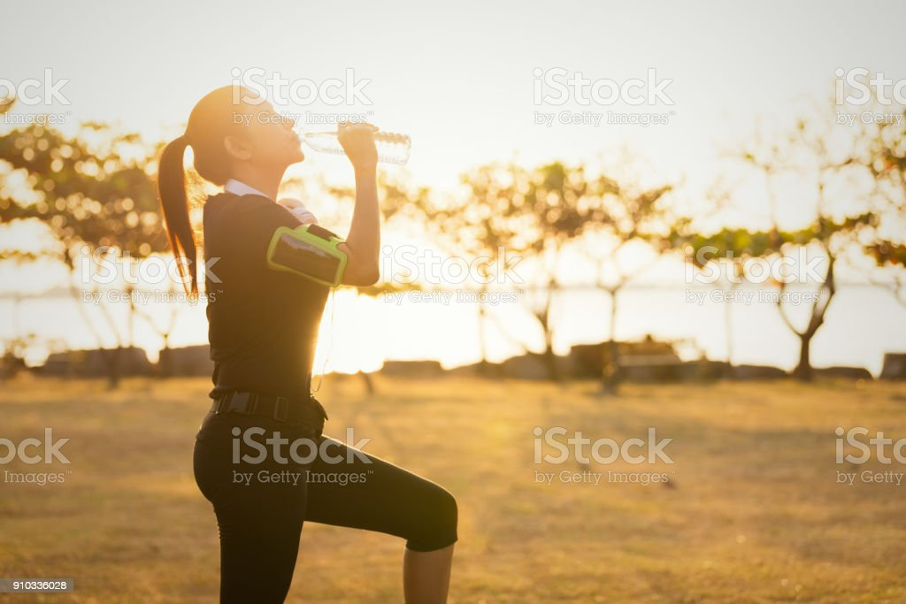 Women walking on a running track. stock photo