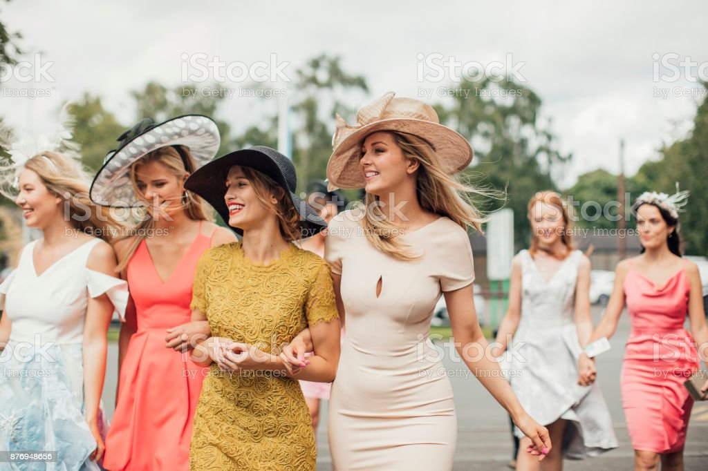 Women Walking to Racecourse stock photo