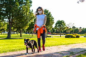 istock Women walking with her dog in park 1224591023