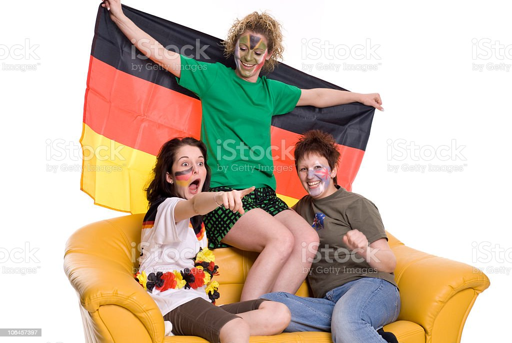 Women watch football on the couch royalty-free stock photo