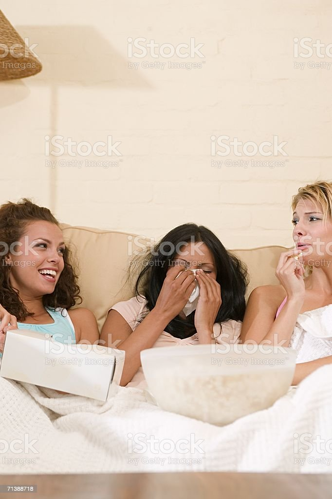 Women watching a sad movie royalty-free stock photo