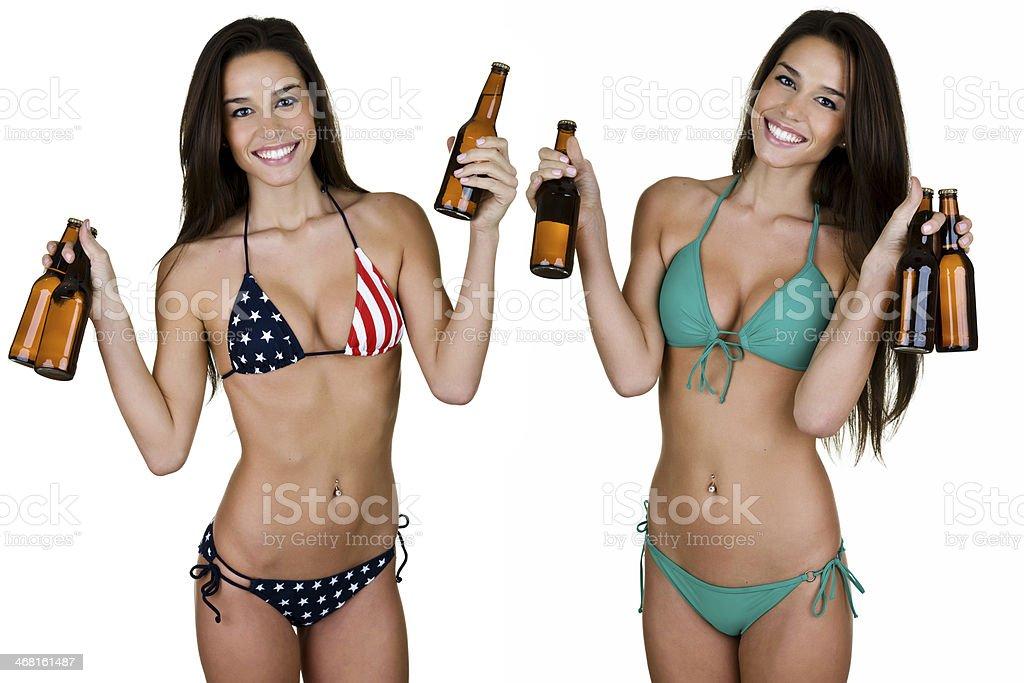 Women wearing bikinis and holding beer bottles stock photo