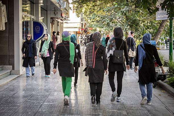 Women wearing islamic scarf walking in streets of Isfahan, Iran - Photo