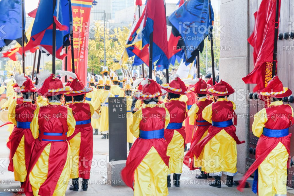 Women wearing Korean traditional dress and holding flags stock photo