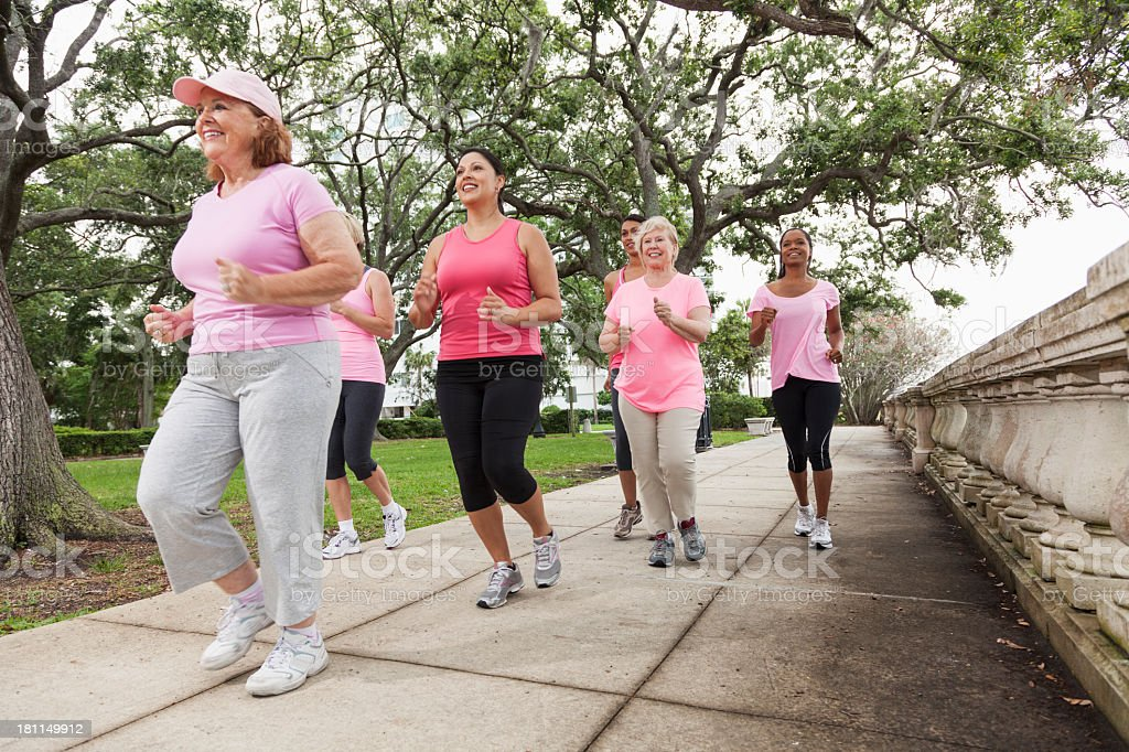 Women wearing pink in breast cancer walk stock photo