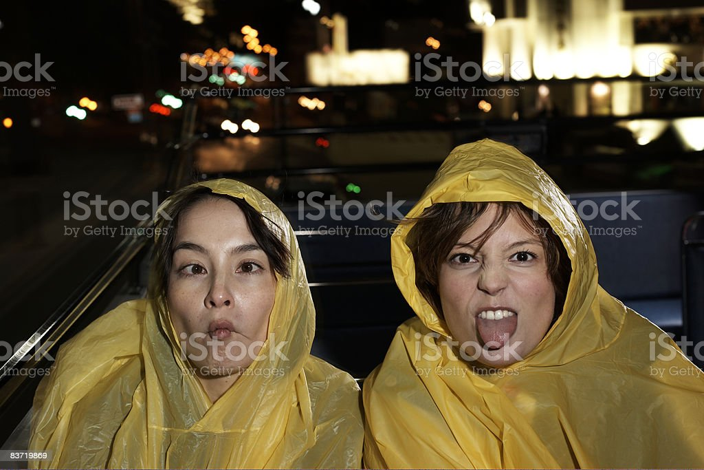 Women wearing waterproofs on open top bus royalty-free stock photo