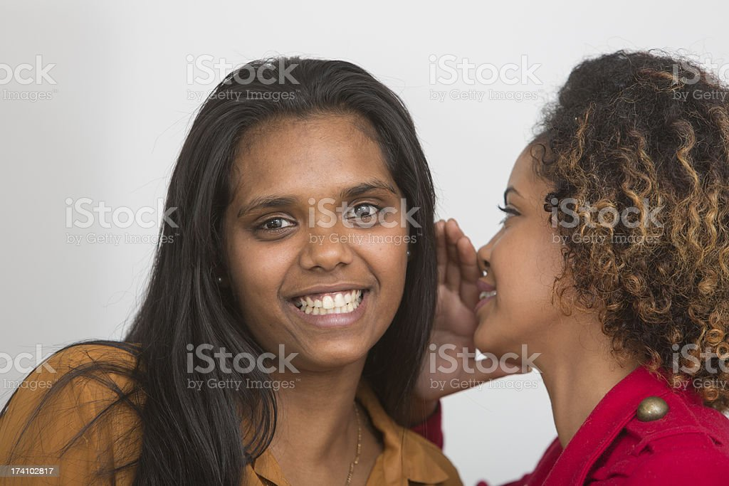 Women Whispering Secrets stock photo