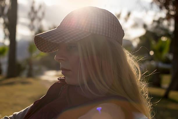 women whit hat sun - byakkaya stok fotoğraflar ve resimler