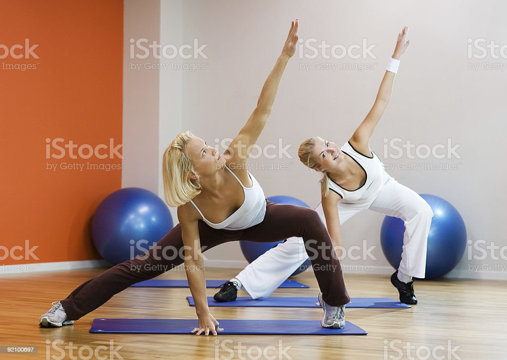 2 women who appear to be doing yoga royalty-free stock photo