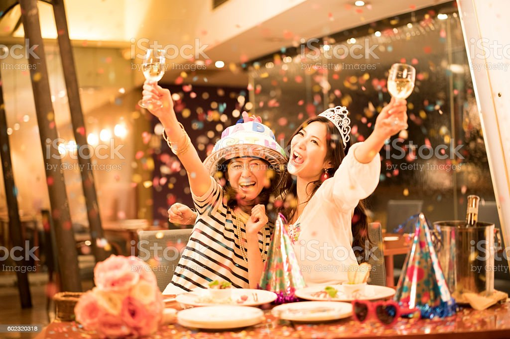 Women who are clamoring at the birthday party stock photo