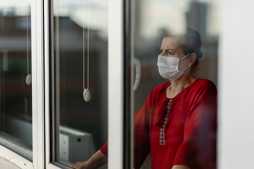 istock women who cannot leave the house due to an epidemic 1213091211