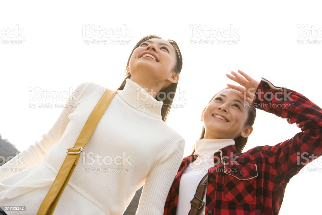 Women who look up to the sky royalty-free stock photo