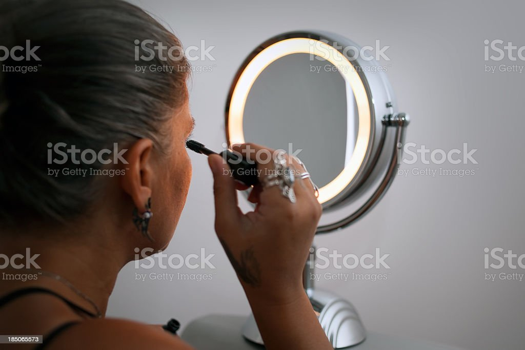 Women who make up at low light royalty-free stock photo