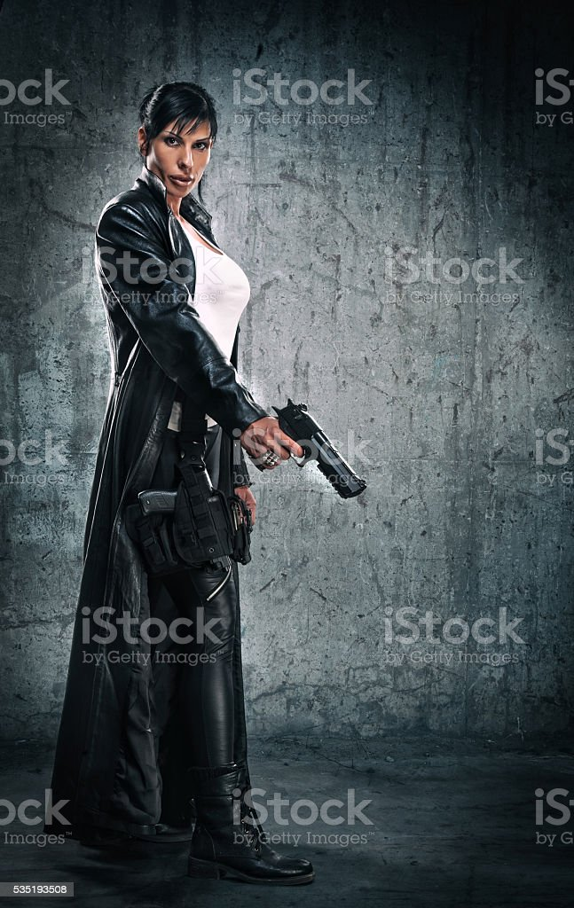 Women with a gun stock photo