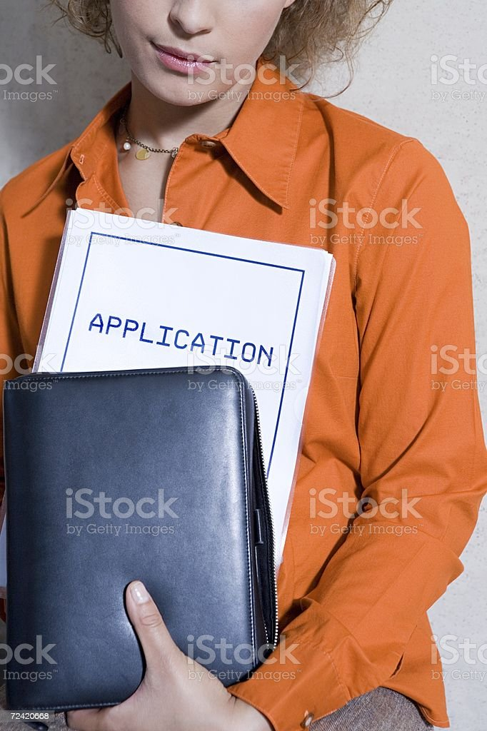 Women with application form royalty-free stock photo