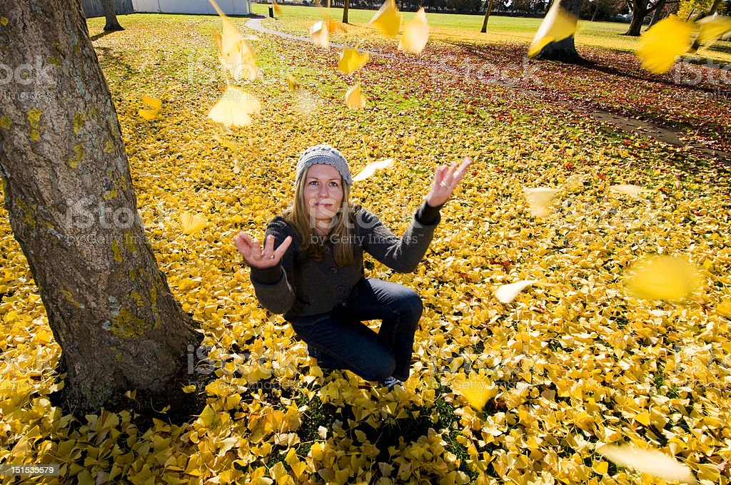 women with  autumn leaves royalty-free stock photo