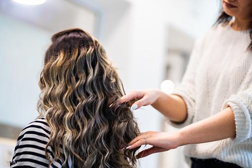 Hair stylist dooing a hair care treatment for client