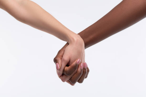 Women with beige nail art holding their hands despite skin color Despite skin color. Women with beige nail art holding their hands despite skin color while feeling equal despite stock pictures, royalty-free photos & images