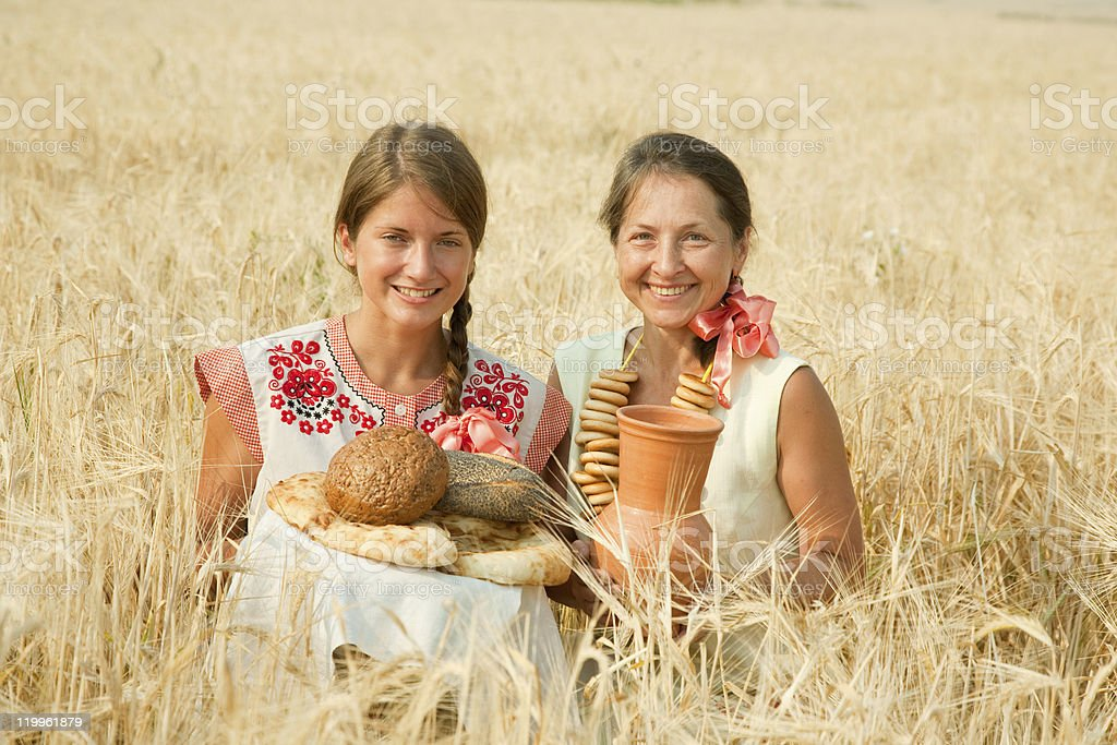 Women with bread at rye field royalty-free stock photo